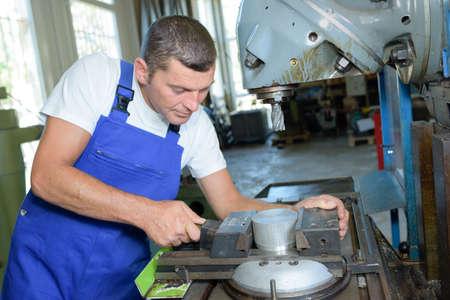manuals: machinist fixing a machine