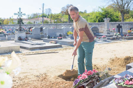 groundskeeper: maintaining a cemetary Stock Photo