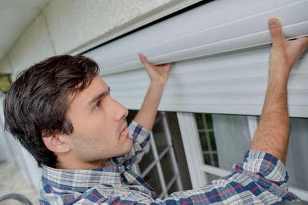 fixing the rolling blinds Standard-Bild