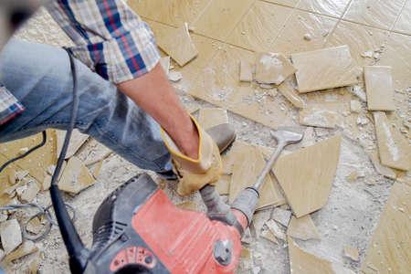 tile cutter: Smashing tiled floor Stock Photo