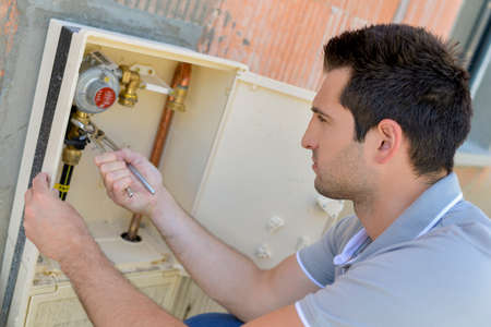 hardware tools: Checking the water meter Stock Photo