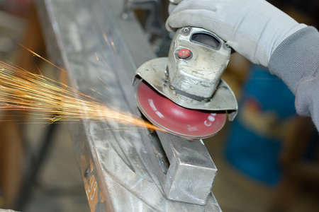 Closeup of angle grinder making sparks