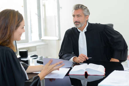 magistrates: Magistrates in discussion Stock Photo