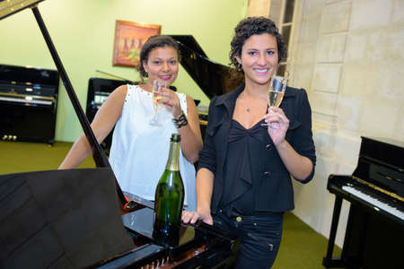 drinking champagne in a piano store