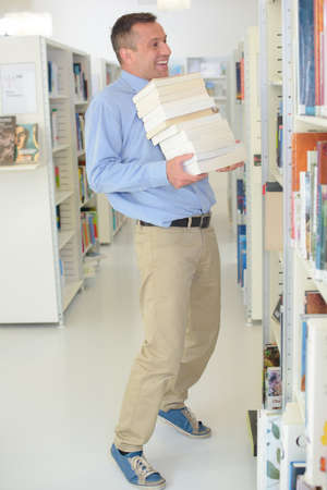 periodical: librarian arranging the books Stock Photo