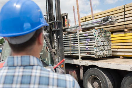 Buidling materials being unloaded from lorry Stock Photo