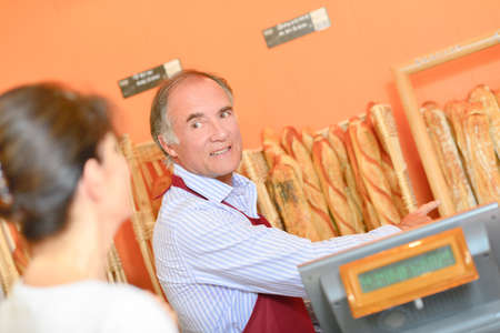 Baker selling his bread Stock Photo