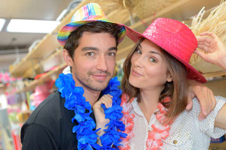 boas: Couple in straw hats and feather boas Stock Photo