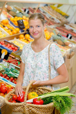 young woman shopping for vegetables Stock Photo
