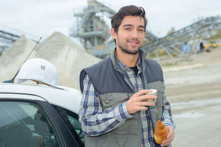 rushed: Builder on a break with food and drink