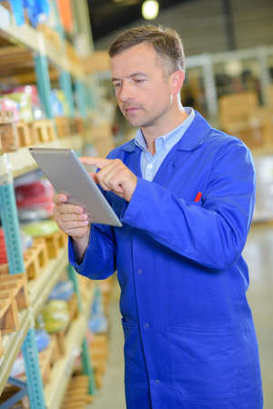 detects: worker in the warehouse using tablet
