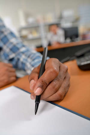 Close-up of a hand holding a pen Stock Photo