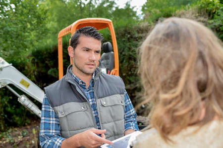 foreman: Foreman explaining to a client Stock Photo