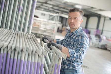 laborer: laborer arranging the products Stock Photo