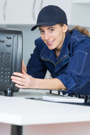 technical service: Portrait of female repairing electric appliance Stock Photo