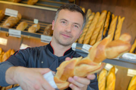 breadbasket: bakery shopkeeper is proud of his bread production
