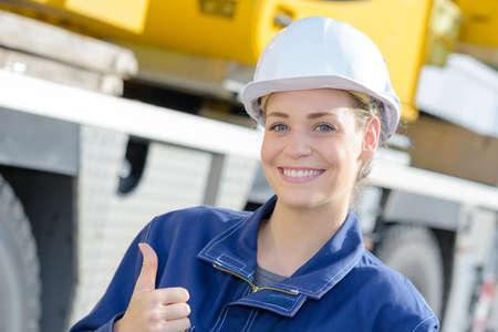 thumbs up from construction worker Standard-Bild