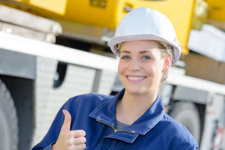 thumbs up from construction worker Stock Photo