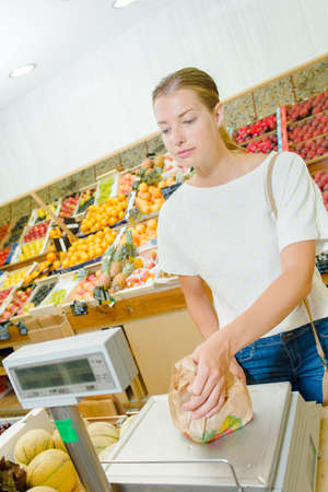 woman weighing in the supermarket Stock Photo