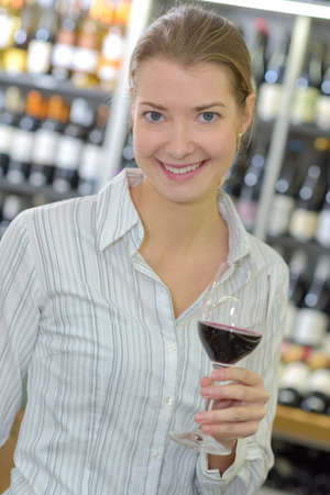 posing with a glass of wine Stock Photo