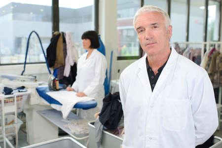 laundrette: Portrait of man in professional laundrette