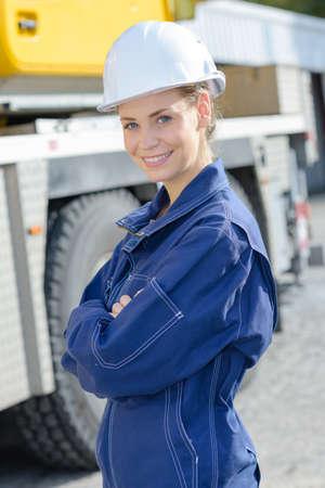 boilersuit: Portrait of woman in boilersuit and hardhat