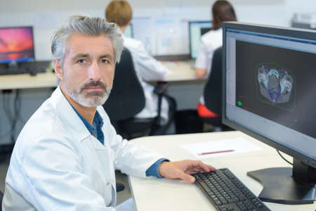 diagnostic findings: healthcare imaging worker Stock Photo