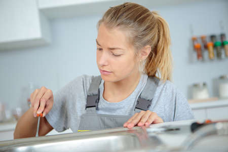 Woman using screwdriver