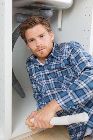posing under the sink