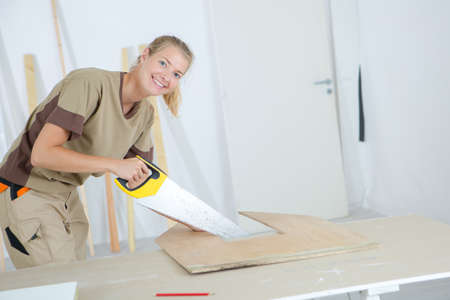 sawing: Woman sawing wood