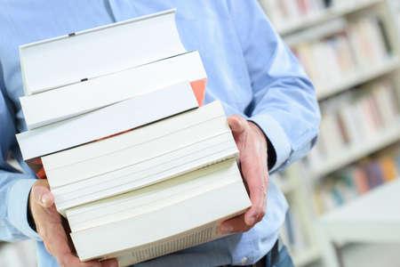 body torso: Body of man holding stack of books