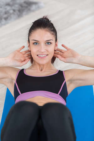 body torso: Lady doing situps Stock Photo