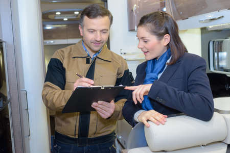 airplan ground technician safety check with flight attendant