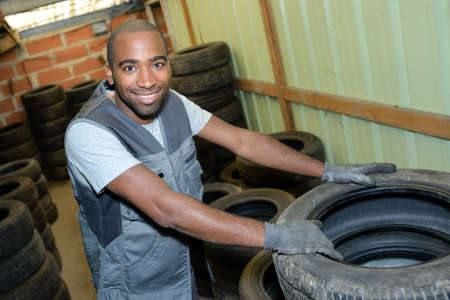 remount: worker with tires Stock Photo