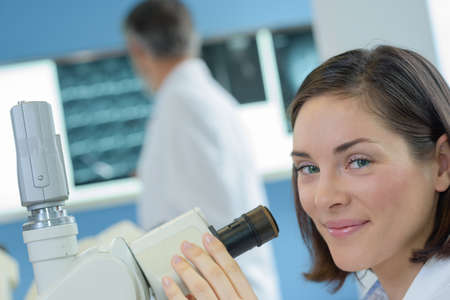 worker and microscope Stock Photo