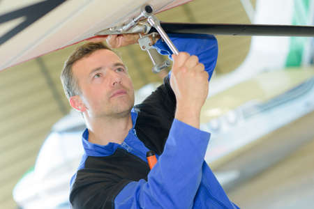 Technician working on an airplane