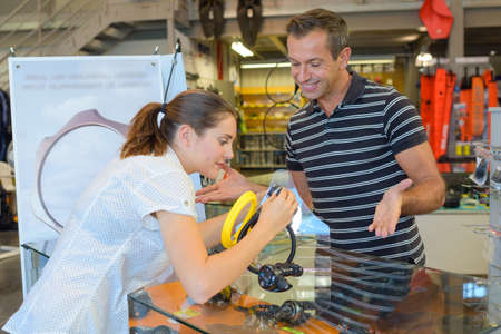 salesgirl: at the diy store Stock Photo