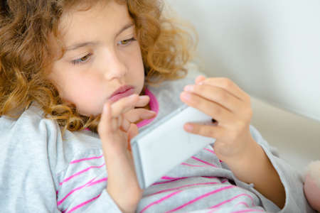 moderation: games in the smartphone Stock Photo