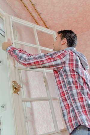 attaching: man attaching a door panel