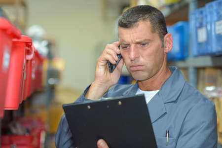 Man on telephone looking frustrated Stock Photo