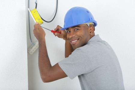 Male electrician working Stock Photo
