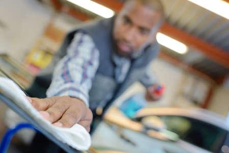 company job: mechanic polishing cars