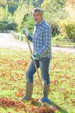 gadener holding a rake Stock Photo