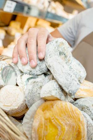 creamery: person handling cheese