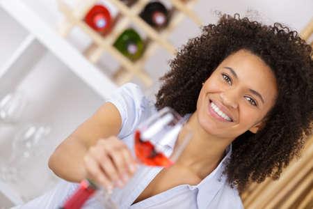 beautiful woman holding a glass of wine Stock Photo