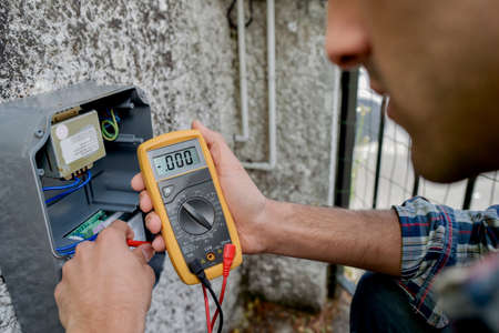 amp: Electrician using a voltmeter device