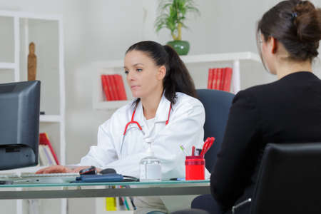 health professional: female doctor and patient