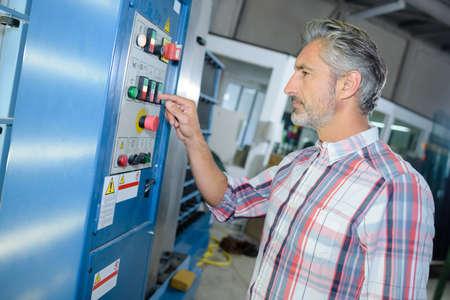 worker man: Man operating factory equipment