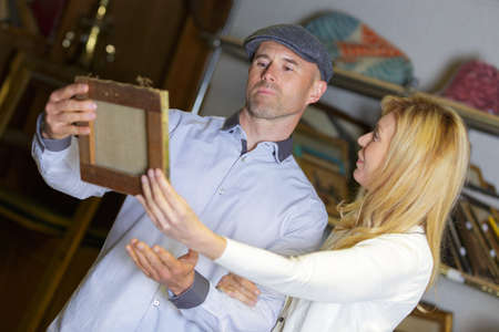 entertainment event: mature couple buying a painting at auction Stock Photo