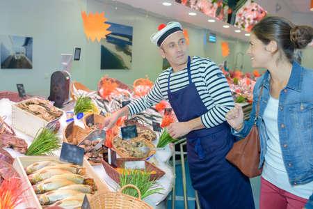 fish vendor: buying iced fish Stock Photo